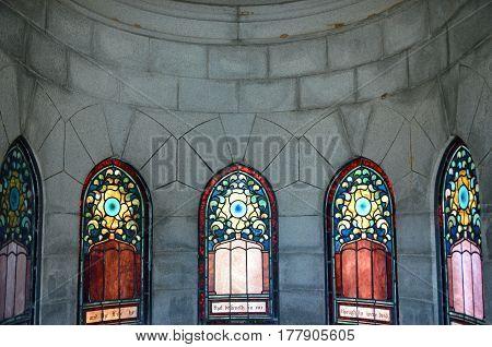 ATLANTA, GA - MAR 15, 2017 Daylight illuminates stained glass windows in the Richards Mausoleum at historic Oakland Cemetery.