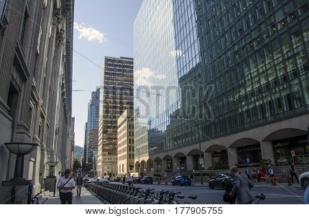 Montreal, Quebec, Canada - 18 July 2016 - Street In Downtown In Montreal In Summertime. Cars, People