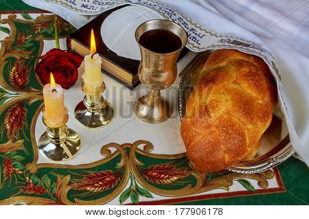 Shabbat Eve Table With Challah Bread, Candles And Kippah.