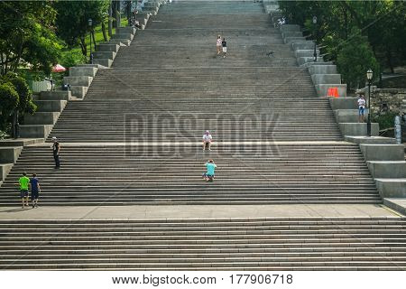 ODESSA UKRAINE - AUGUST 6 2014: Potemkin stairs with people posing on them. The Odessa stairs that have been picture in the famous Soviet movie Potemkin are a major landmark of this Ukrainian city