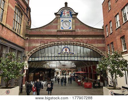 WINDSOR - MARCH 20, 2017: Pedestrians and retail outlets at Windsor Royal Shopping Central at Windsor & Eton Central Train Station in Windsor, Royal Berkshire, UK.