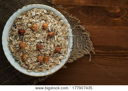 Muesli With Nuts Hazelnuts . Muesli On A Wooden Table. Muesli Top View . Healthy Food