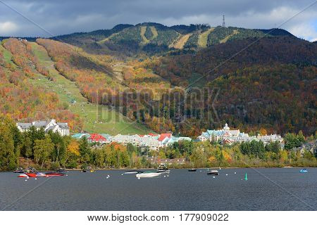 Lake Tremblant and Mont-Tremblant village in fall with fall foliage, Town of Mont-Tremblant, Quebec, Canada.