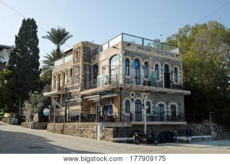 TIBERIAS ISRAEL - FEBRUARY 26 2017: Boutique Hotel Shirat Hayam (Song of the Sea) on the promenade in Tiberias. Inscription: Boutique Hotel Song of the Sea