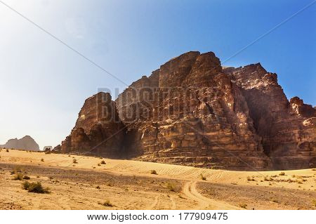 Yellow Sand Rock Formation Wadi Rum Valley of the Moon Jordan. Inhabited by humans since prehistoric times place where TE Lawrence of Arabia in the early 1900s