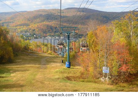 MONT TREMBLANT, QC, CANADA - OCT. 5, 2014: Lake Tremblant and Mont-Tremblant village in fall with fall foliage, from top of Mont Tremblant, Quebec, Canada.