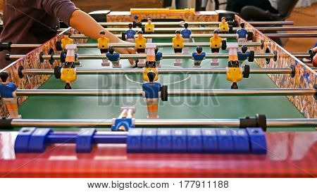 Father and child play kicker table football soccer. Baby-foot game.