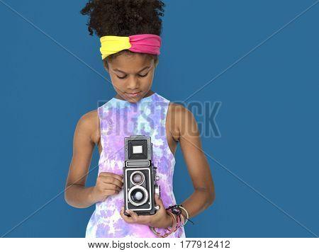 Little african girl holding camera