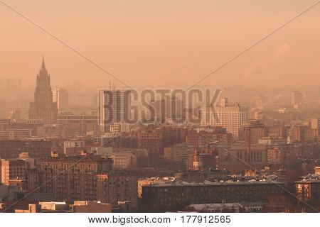 Close-up shooting from high point of metropolitan city: residential buildings and districts illuminated by morning sun tower multiple facades and windows Government building hazy horizon Moscow