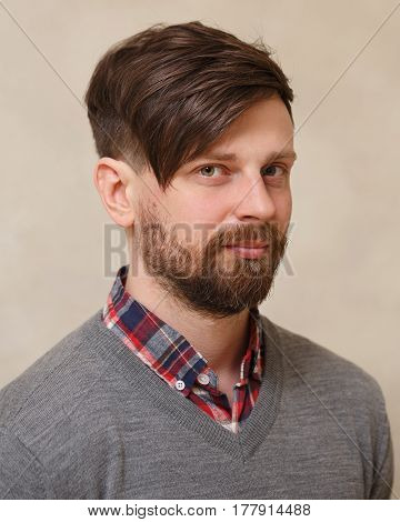 Men's fashion haircut. Beauty saloon. Male beauty. The client is a hipster. An example of a hairdresser's work.