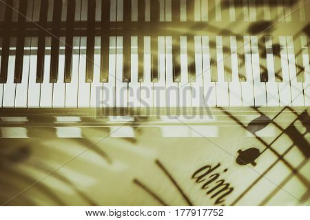 Piano keyboard background with selective focus and blur. Double exposure of keyboard and musical notes