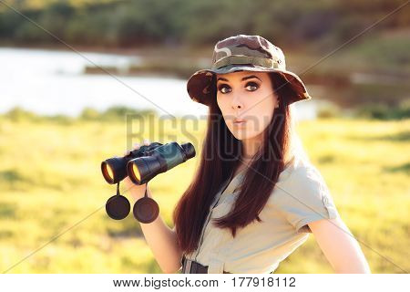 Surprised Explorer Girl with Camouflage Hat and Binoculars