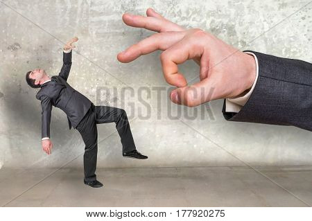 Falling Small Businessman And Big Businessman