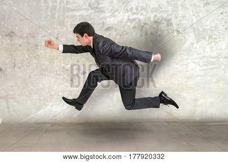 Small Businessman Running Away