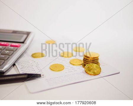 Saving Account Book from Bank for Business Finance with pen, calculator and coin