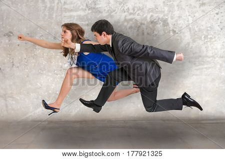 Small businesswoman and businessman running away from a boss pressure