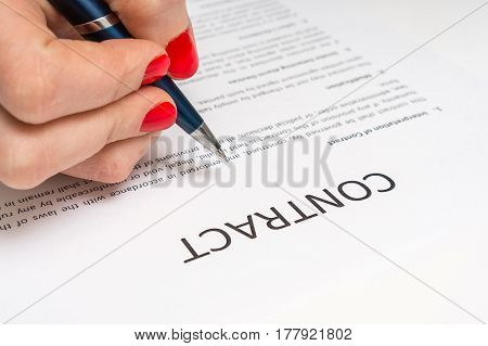 Business Woman Signing Contract Document In Office