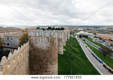 Avila Spain - November 11 2014: The Medieval Walls of Avila. The old city and its extramural churches were declared a World Heritage site by UNESCO