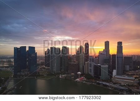 Drone shot of singapore cityscape building skyline at twilight, modern city architecture urban metropolis