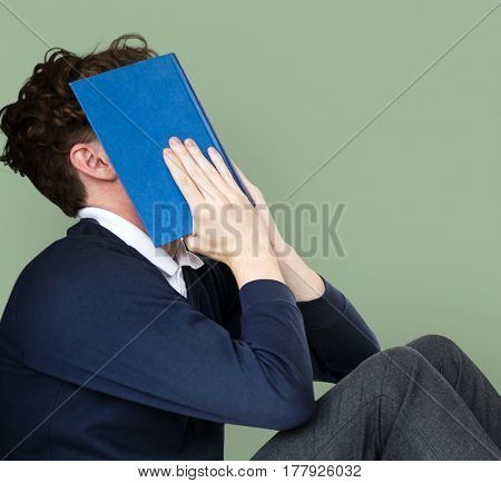 Man stressed and tried with reading exam