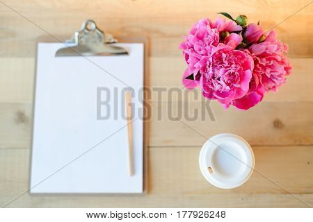 Clipboard, Cup And Flowers