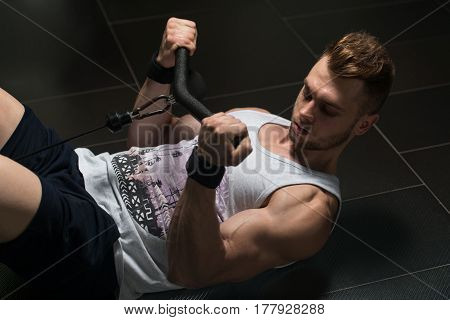 Bodybuilder Exercising Biceps In Undershirt
