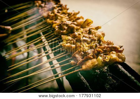 Indonesian traditional local food sate or satay on grill with smoke photo taken in Jakarta Indonesia java