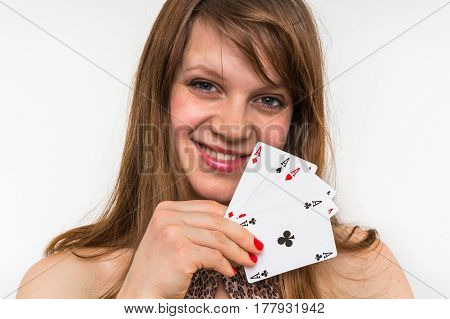 Attractive Woman With Poker Cards Isolated On White