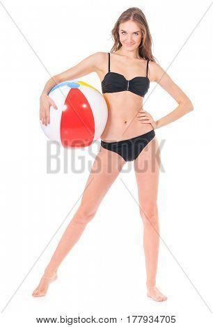 Pretty girl posing in black bikini with beach ball, isolated on white background