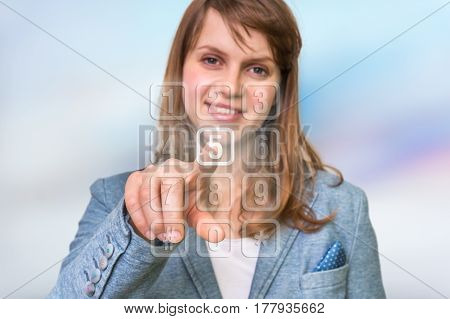 Woman Pressing Numerical Button On Virtual Touch Screen