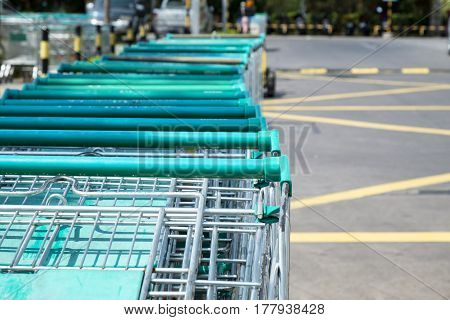 close up of shopping carts for supermarket supermarket cart outdoor parking in day light at front of the mall.