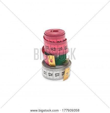Diet concept. Colorful measuring tapes isolated on white background
