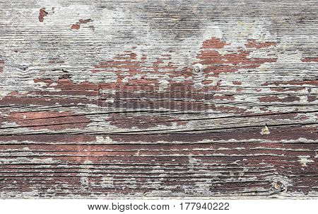 The old wooden planks of a barn with peeling paint