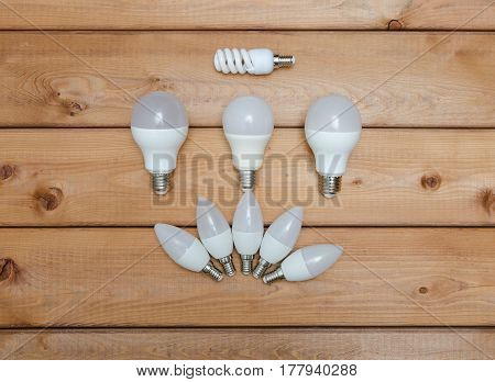 Energy saving and light emitting LED bulbs on wooden background