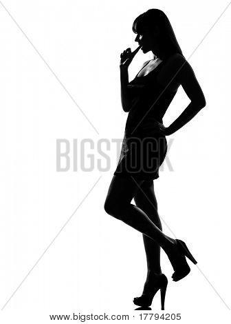 stylish silhouette caucasian beautiful woman thinking choosing seductress full length on studio isolated white background