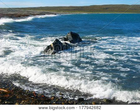 Background blurred landscape waves near the coast of the Rybachiy peninsula on the Barents Sea, Murmansk region