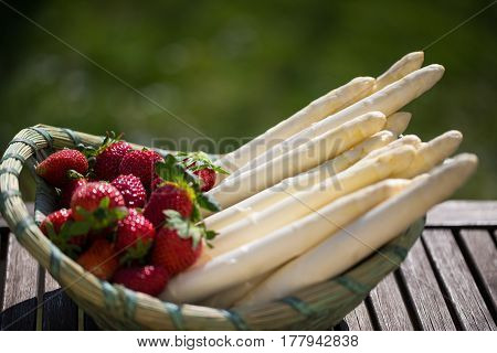 Asparagus and strawberries in the basket, white asparagus