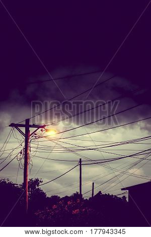 Street light at night with a stormy sky background. Dark mystery scene