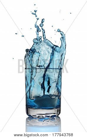 Splash In Glass Of Blue Alcoholic Cocktail Drink With Ice Cube