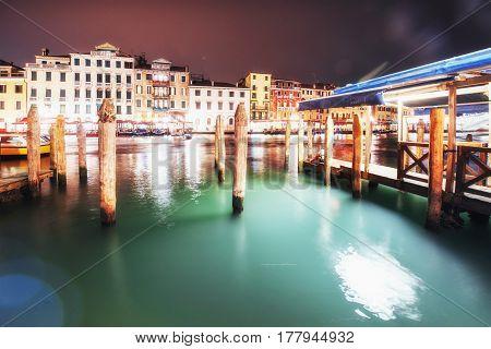City Landscape. Rialto Bridge Ponte Di Rialto In Venice, Italy At Night.