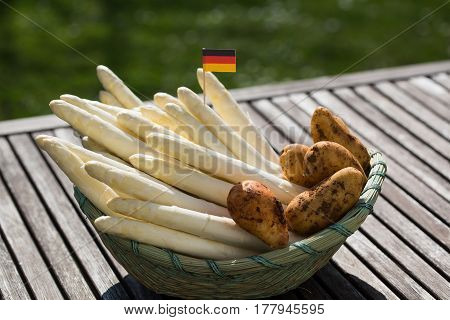 Asparagus white asparagus and potatoes in the basket