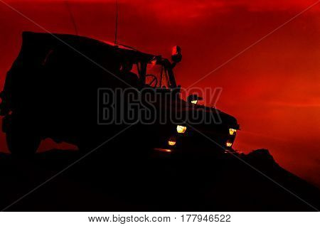 MILITARY OFF-ROAD VEHICLE - Car on a dirt road at dusk