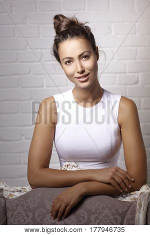 Portrait of attractive young woman smiling, looking at camera.