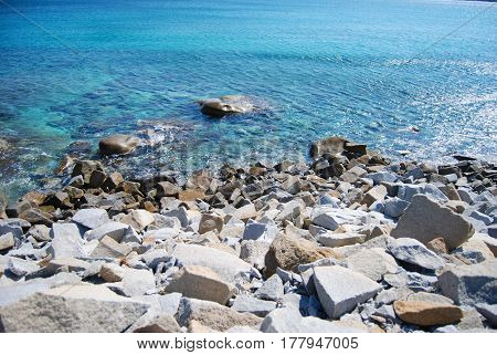 Rock Beach In Cava Usai (villasimius, Sardinia, Italy). Blue Sea And Sunny Day