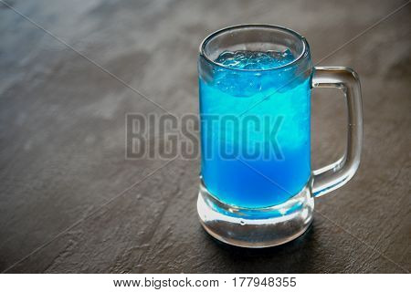 Blue Lime Soda on a wooden table background