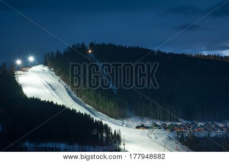 Ski piste and village of Bukovel ski resort in Carpathians, western Ukraine
