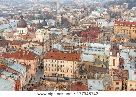 Market Square and surrounding historic buildings in the center of old Lvov, Ukraine