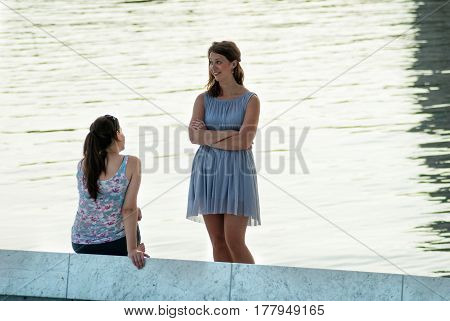 Oslo Norway - July 22 2014: girls on the embankment of Bjorvika bay near Opera house