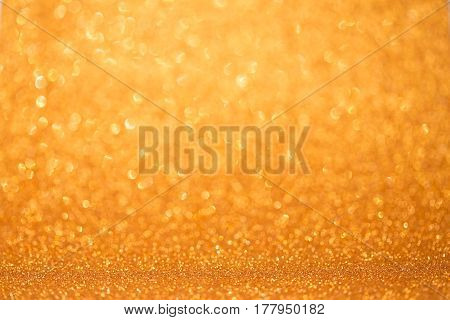 The orange glittering abstract light as background