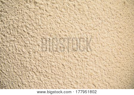 Vintage and grunge gold, cream or beige background of natural cement or stone old texture , retro pattern wall. Conceptual or metaphor wall banner, material, aged, solid website background.